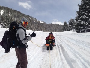 Snowboarding behind a snowmobile