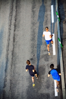 people running on road